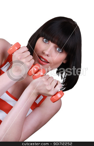 Woman with orange weights stock photo, Woman with orange weights by photography33