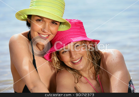 Portrait of two women at the beach stock photo, Portrait of two women at the beach by photography33