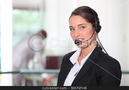 Woman wearing headset stock photo, Woman wearing headset by photography33