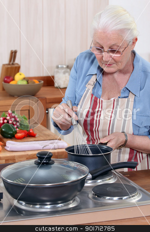 Senior woman cooking stock photo, Senior woman cooking by photography33