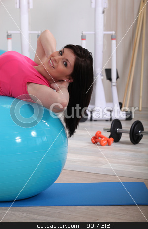 young woman doing stability ball abs exercises in the gym stock photo, young woman doing stability ball abs exercises in the gym by photography33