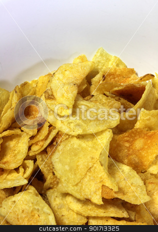 Pile of Potato Chips stock photo, A close-up of a bowl of greasy potato chips.  by Chris Hill