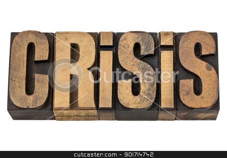 crisis word in vintage wood type stock photo, crisis - isolated word in vintage letterpress wood type by Marek Uliasz
