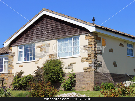 Bungalow home in summer stock photo, Exterior of modern bungalow home in summer with blue sky background. by Martin Crowdy