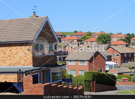 English housing estate stock photo, English housing estate with blue sky background. by Martin Crowdy