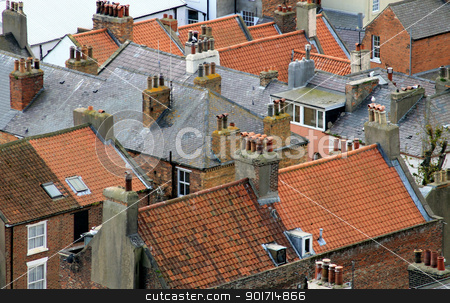 Old house roofs stock photo, Old house roofs with red tiles in city or town; crowded housing concept. by Martin Crowdy
