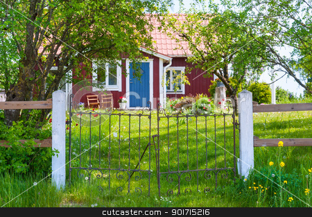 Entrance of red wooden cottage in Sweden stock photo, Entrance of a typical red wooden cottage on the island of Oeland, Sweden by Kai Schirmer
