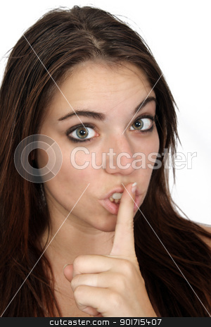 Attractive Secretive or Quiet Brunette (1) stock photo, A close-up of an attractive brunette with bare shoulders and her finger over her lips as if signaling quietness or a secret. by Carl Stewart