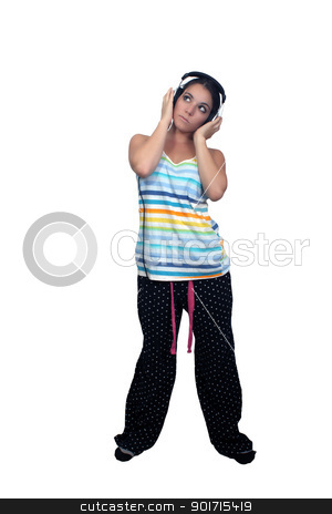 Attractive Brunette with Headphones (2) stock photo, An attractive brunette listens to music in her headphones, dressed in pajamas or sleepwear.  Isolated on a white background with generous copyspace. by Carl Stewart