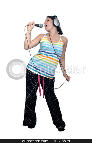 Attractive Brunette with Headphones and a Microphone (1) stock photo, An attractive brunette sings along with music in her headphones, dressed in pajamas or sleepwear.    Isolated on a white background with generous copyspace. by Carl Stewart
