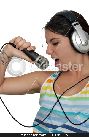 Attractive Brunette with Headphones and a Microphone (4) stock photo, An attractive brunette sings along with music in her headphones, dressed in pajamas or sleepwear.  Isolated on a white background with generous copyspace. by Carl Stewart