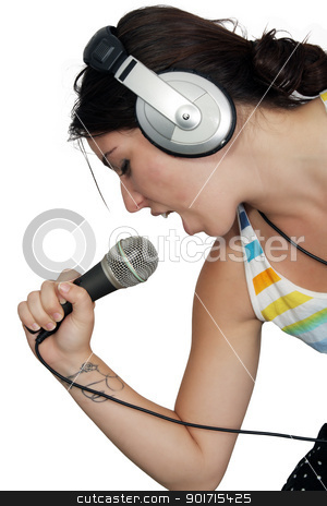 Attractive Brunette with Headphones and a Microphone (5) stock photo, An attractive brunette sings along with music in her headphones, dressed in pajamas or sleepwear.  Isolated on a white background with generous copyspace. by Carl Stewart