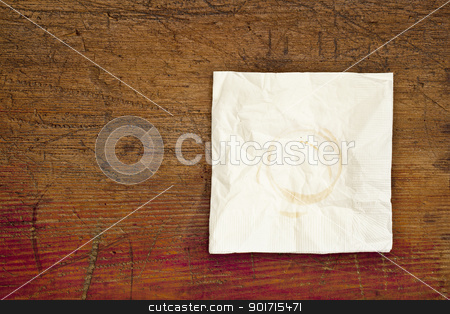 napkin with coffee stains stock photo, napkin with coffee stains on a grunge scratched wooden table by Marek Uliasz