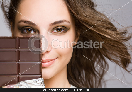 Chocolate seduction stock photo, Chocolate seduction, portrait of a brunette beauty with tasty dark chocolate. by exvivo
