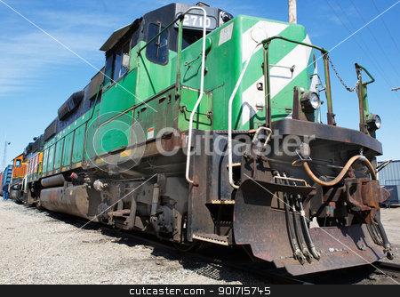Freight Train stock photo, Green and weight freight train with blue sky background by bobkeenan