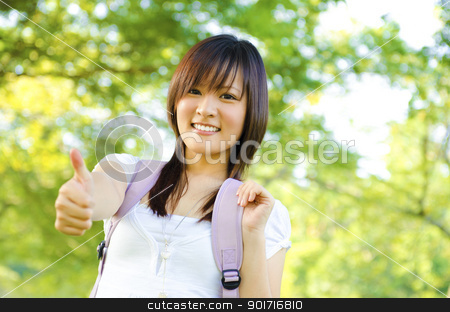 Thumb up college girl stock photo, Mixed race thumb up college girl standing at campus by szefei