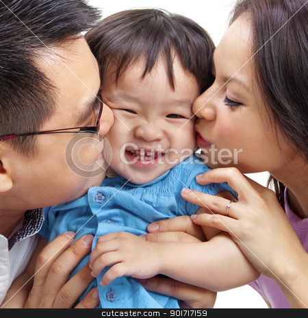 Love stock photo, Parents giving their daughter a kiss. by szefei