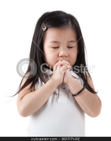 Praying girl stock photo, Little girl praying on white background by szefei