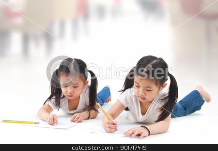 Drawing stock photo, Little Asian girls drawing, lying on floor by szefei