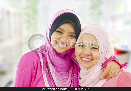 Happy Muslim women stock photo, Happy Muslim women standing inside house by szefei