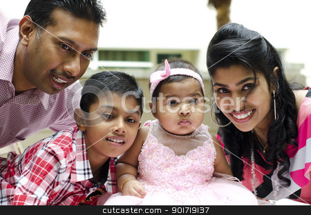 Happy Indian family stock photo, Happy Indian family having fun time at outdoor by szefei