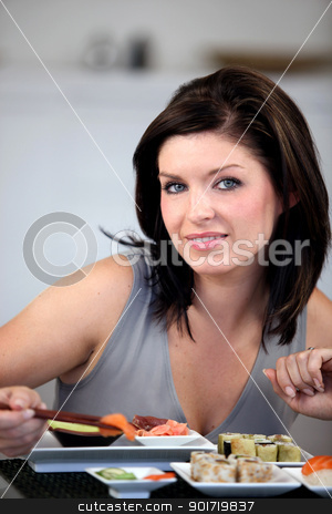 Brunette eating sushi stock photo, Brunette eating sushi by photography33