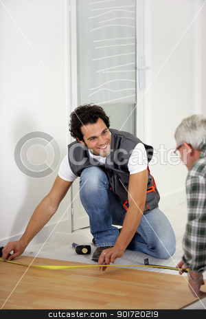 Man measuring flooring stock photo, Man measuring flooring by photography33