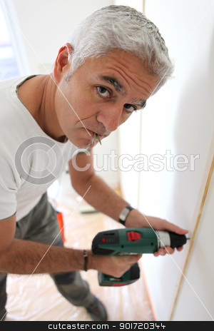 Man using an cordless screwdriver stock photo, Man using an cordless screwdriver by photography33