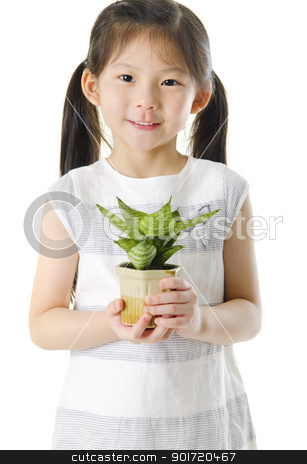 Go Green stock photo, Concept of little girl holding a plant on white background by szefei