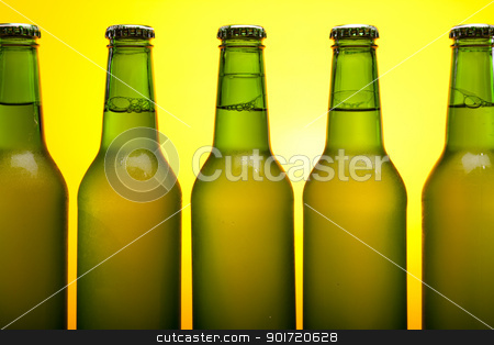 Chilled beer on yellow background stock photo, Chilled beer on yellow background by fikmik