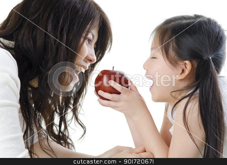 Healthy eating stock photo, Mother and daughter sharing an apple on white background by szefei