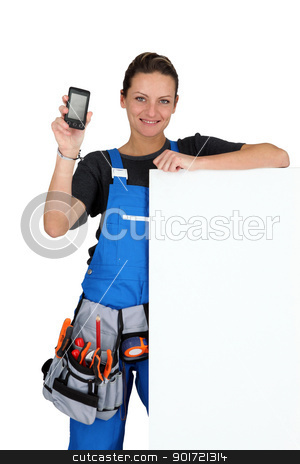 Woman with blank board, toolbelt and cellphone stock photo, Woman with blank board, toolbelt and cellphone by photography33