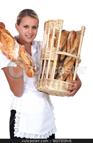 Bakery worker holding basket of bread stock photo, Bakery worker holding basket of bread by photography33