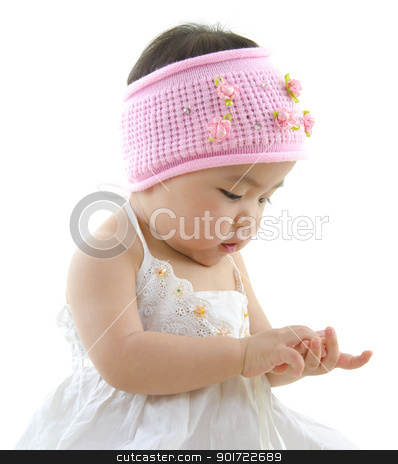 Asian baby girl stock photo, Asian baby girl playing with her hand by szefei