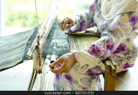 Songket weaver stock photo, The process of traditional Songket weaver by szefei