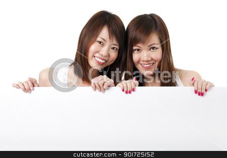 Oriental girls with blank sign stock photo, Oriental girls with blank sign, isolated on white background by szefei