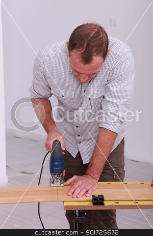 Man with band saw stock photo, Man with band saw by photography33