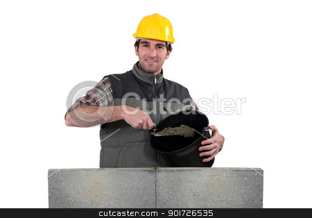 Bricklayer with a bucket of cement stock photo, Bricklayer with a bucket of cement by photography33