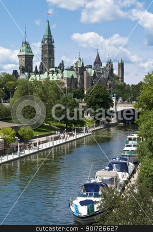 Summer Parliament stock photo, Yachts mooring on the Rideau Canal below the Parliament Centre Block in Ottawa Canada. by Michel Loiselle