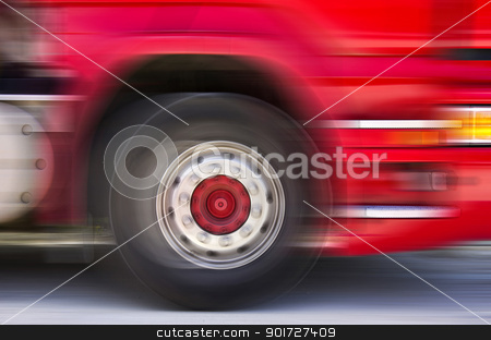 Truck in motion stock photo, A fast moving truck passes by, with motion blur. by Ansebach