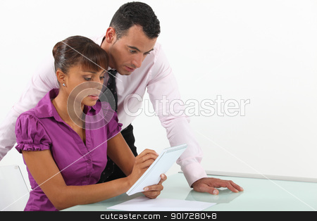 Two businesspeople writing down  ideas stock photo, Two businesspeople writing down  ideas by photography33