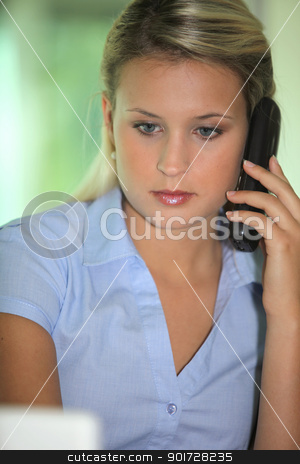 Blond receptionist taking a call stock photo, Blond receptionist taking a call by photography33