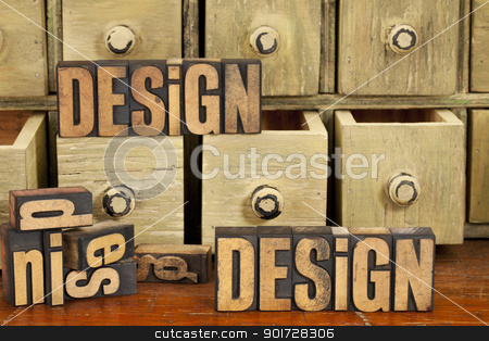 design concept in wood type stock photo, design concept - words in vintage letterpress wood type and primitive rustic wooden apothecary drawer cabinet by Marek Uliasz