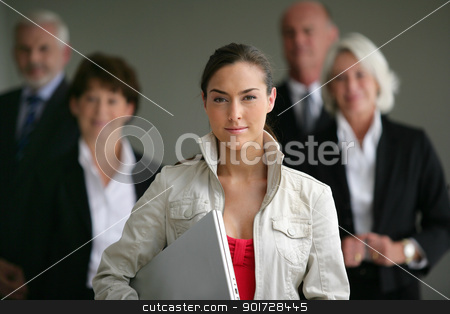 An intern posing with her superiors stock photo, An intern posing with her superiors by photography33