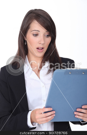 Young woman surprised at her clipboard stock photo, Young woman surprised at her clipboard by photography33