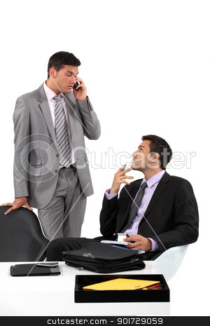 Businessmen patiently waiting for their client to arrive at a meeting stock photo, Businessmen patiently waiting for their client to arrive at a meeting by photography33