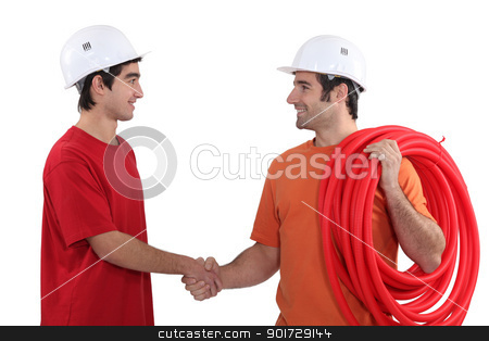 Two electricians shaking hands stock photo, Two electricians shaking hands by photography33