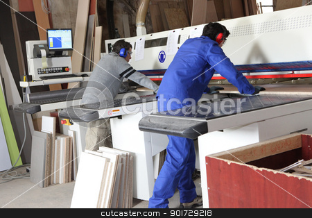 Two men using factory equipment stock photo, Two men using factory equipment by photography33