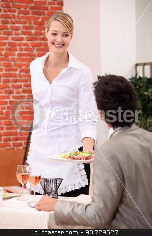 Waitress handing meal to customer stock photo, Waitress handing meal to customer by photography33