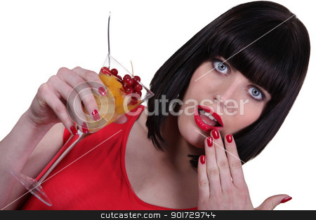 Stunning woman with a glass of fruit cocktail stock photo, Stunning woman with a glass of fruit cocktail by photography33